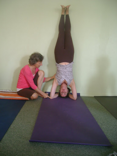 Catherine Being Instructed In Headstand By Lillah Schwarz