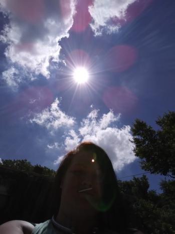 Divine Light of Pink Orbs Above Angela Depew in Rockford, Illinois on July 3, 2018