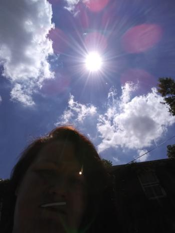 Pink Orbs Above Angela Depew in Rockford, Illinois on July 3, 2018